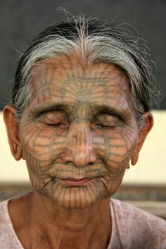 Africa | Traditionally tattooed lady in the Chin State | ©Sensaos, via flickr