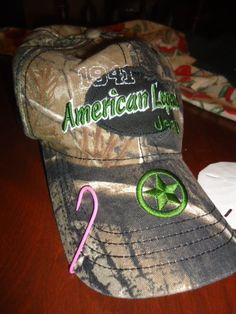 Pink fish hook for breast cancer <3 with a camo hat  ...my hat