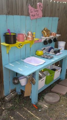 Our daughters Fancy Mud Pie table! A recycled potting table purchased off of Craigs List for cheap. I had my husband adjust the table height and cut out spaces for the basins. Used left over paint from previous projects to give the shelves I bought at GW Kids Outdoor Play, Kids Play Area, Backyard For Kids, Diy For Kids, Garden Kids, Backyard Ideas, Play Areas, Play Spaces, Backyard Playground
