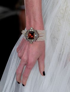 See all the Details photos from Marchesa Spring/Summer 2013 Ready-To-Wear now on British Vogue Pearl Bracelet, Pearl Jewelry, Jewelery, Vintage Jewelry, Jewelry Box, Jewelry Making, Handmade Bracelets, Jewelry Bracelets, Bangles