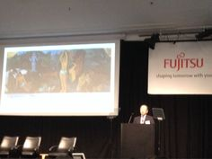 "Hideyuki Saso, the president of fujitsu Labs ltd. is quoting Paul Gauguin's painting ""Where are we from? Where Fujitsu is heading?"" #FLATS2014"