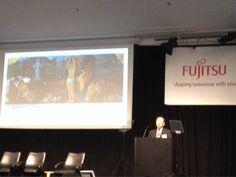 "Hideyuki Saso, the president of fujitsu Labs ltd. is quoting Paul Gauguin's painting ""Where are we from? Where Fujitsu is heading?"" #FLATS2014"