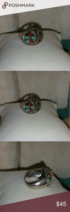 Sterling silver Turquoise Coral flower flat ring Sterling silver. .has a turquoise and red coral flower..flat top design..scroll cut out..band ring.. look at pic for weight, size.. stamped 925.. it was from either Ross Simons or QVC bought it years ago..now as you can see it doesn't fit anymore.. qvc Jewelry Rings