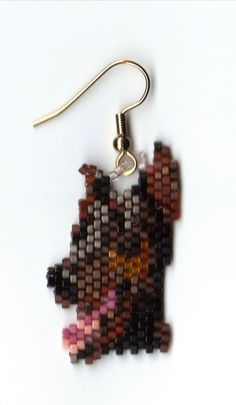 a sweet little pair of hand beaded doberman dog head dangle earrings