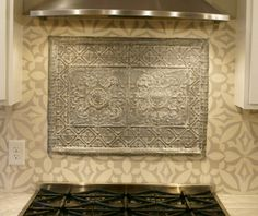 """Tin ceiling tile combined with Avente Tile's Zebra B 8"""" x 8"""" Cement Tile is used for the backsplash of a client's kitchen redesign project."""