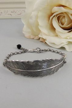 Hey, I found this really awesome Etsy listing at https://www.etsy.com/listing/115020637/silver-featherbraceletsilver-bracelet