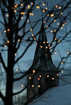 Church steeple with Christmas lights