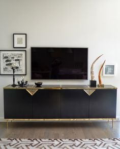 what i like: TV mounted flush to wall, low long storage console, pictures in frames to offset the TV