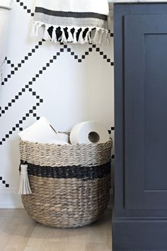 black and neutral Target Threshold woven basket for toilet paper storage