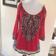 INC Cold Shoulder Blouse Red background,with designs,fake silver studs in design.Three quarter see through sleeves.Body of blouse fully lined.Cold shoulder style.Excellent condition.100% nylon.Size Petite,which fits a 2 Petite.❌❌NO TRADES❌❌ INC International Concepts Tops Blouses