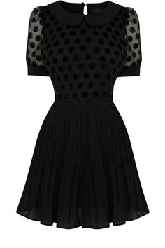 This polka dot top has a full skirted bottom and puff short sleeves. With a round neckline, this piece is slightly sheer to the sleeves and sits just below the hip.