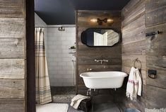Warm, reclaimed barn wood on the walls. Roku white glass tile from Walker Zanger adds a contemporary note to an old-fashioned bath. Sumba Speckled pebble tile by Island Stone. Modern Bathroom Design, Bathroom Decor, Bathrooms Remodel, Bathroom Design Decor, Rustic Bathroom Vanities, Rustic Bathrooms, Rustic Modern Bathroom, Bathroom Design, Best Bathroom Designs