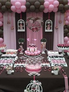 I like the use of a dark brown/black with pink in this party decor