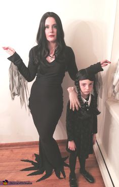 Morticia and Wednesday Addams with Thing - Halloween Costume Contest via @costume_works