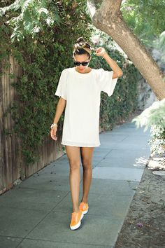 White shift dress with orange tennis shoes