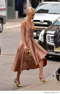 Nude dress and gold accessories