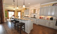 Whether you love to cook- or just love to eat- this gourmet kitchen is a dream, overlooking a charming breakfast nook!