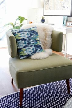 Olive green chair with navy carpeting