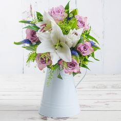 Send this bouquet of oriental lily, memory lane rose, blue veronica and greenbell to your loved one to make any occasion extra special. This floral delight is perfect for birthdays, thank-you's or any occasion when you want to send your best wishes. Valentines Flowers, Valentines Day, Oriental Lily, Flowers Delivered, Red Roses, Birthdays, Bouquet, Make It Yourself, Create