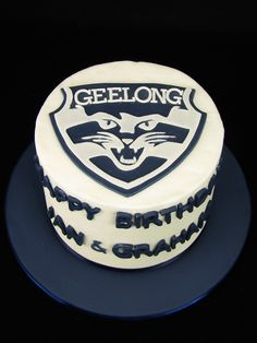 Geelong football cake: My client wanted to give her neighbours a special treat with a small cake themed around the Geelong Footy Club. Carn the Cats! This is a vanilla butter cake filled and covered in buttercream and decorated with a hand made fondant logo.