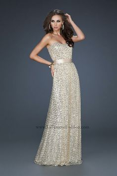 La femme sequin gown with matching ribbon belt