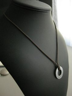 Giving him a necklace with his initial or name engraved in it could also be a good gift.
