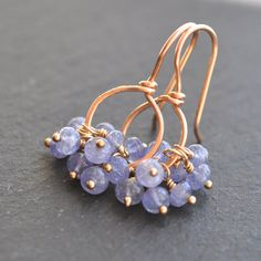 Tanzanite earrings.    I have been dying to get my hands on some smooth tanzanite beads ever since I saw a strand of these in Bangkok a few years back.