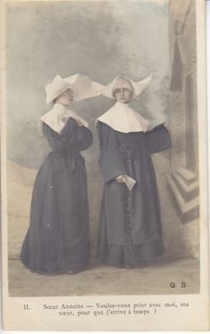 Another version of a traditional French nun habit on a vintage postcard, circa 1900.