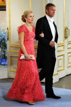 Anna Westling Blom, sister of the groom, and partner Mikael Soederstroem attend the wedding ceremony between Crown Princess Victoria of Sweden and Daniel Westling at Stockholm Cathedral on June 19, 2010 in Stockholm, Sweden.
