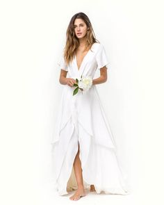 18 Stunning Wedding Dresses For The Beach-Bound Bride - White beach dresses that everyone will just assume are expensive and sand-appropriate Source by jschilling - Stunning Wedding Dresses, Bohemian Wedding Dresses, Casual White Wedding Dress, Minimal Wedding Dress, Casual Bride, Bohemian White Dress, Simple White Dress, White Wrap Dress, White Maxi