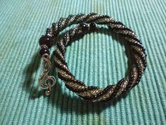 Passione Perline: Bracciale spirale nero e argento