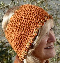 Colorado clothing. This is a unique headband in orange, brown and mint green. Wide headbands are made for the person who wants warm ears, but not a full head cover. Head band measures 22 around the face at the scallop edge, 20 at the center and 18 at the top of the head. It will easily fit a medium 22 head. There is some elasticity in the head band. The yarn is wool, polyamide and acrylic. It is soft and comfortable. This head band, as are all of my creations, is made with no pattern, just…