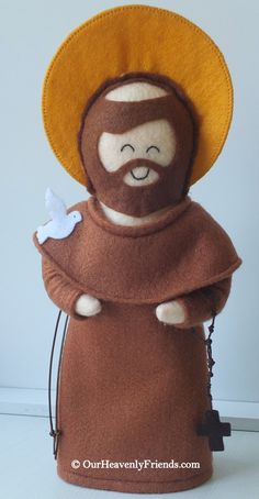 Lovingly handmade by Our Heavenly Friends from felt fabric and stuffed with 100% premium poly-fill. St. Francis of Assisi is dressed in a brown robe, matching trousers, a cowl, cord belt and a mini cord Rosary. The cord belt and Rosary are both removable. Saint Francis of Assisi had a special place in his heart for all wild creatures and is therefore depicted with a dove perched on his shoulder.  The doll features a prayer on the back that tells you more about the Saint and encourages your…