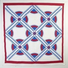 """The New York Beauty is a quilt pattern that is always popular and rarely seen. It is a difficult one to execute with the entire pattern consisting of curves and points. This striking example is nicely quilted with feather patterns in the white blocks. Measurements are 79"""" x 82"""". Excellent condition; circa 1930"""