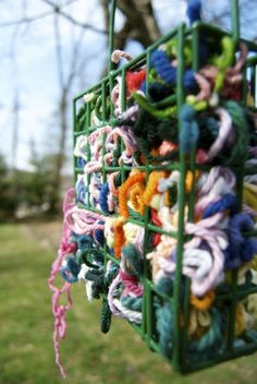 Place scraps of yarn in a suet feeder and birds will use them to make their nests. Place scraps of yarn in a suet feeder and birds will use them to make their nests.