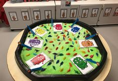 EYFS Maths - Dinosaur colour sorting with tweezers and green snow