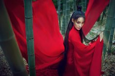 Writing prompt. Photo that tells a story. The Enchantress. Red