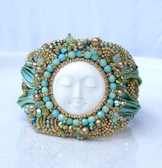 Bead Embroidered Shibori Silk Bracelet Bead Embroidery Bracelet Shibori Silk Ribbon Summer Fashion Summer Trends Turquoise Gold by RedTulipDesign on Etsy https://www.etsy.com/listing/197617340/bead-embroidered-shibori-silk-bracelet