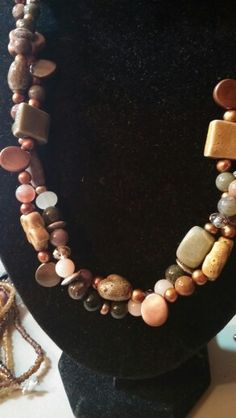 Ceramic,freshwater pearl, acrylic, and jasper double,strand necklace.