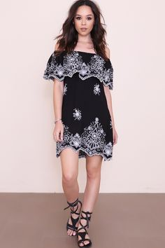 Embroidered layered woven dress. Elasticized neckline. Off the shoulder sleeves. Unlined. Style #: 1925 Material: Rayon/Polyester Color: Black/White Model is wearing a small
