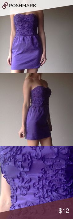 Purple strapless dress with floral detailing Gorgeous purple mini dress with floral detailing at the top and a lovely bow that ties in the back. Perfect for a nice night out with heels and a simple dainty necklace. Worn once, flawless condition. Arden B Dresses Mini
