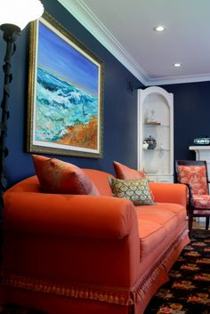 Traditional Style living room with Midnight Blue walls looks dynamic with the complimentary color Orange sofa is a interior design project from Jane Hall Design