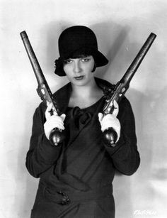 Louise Brooks. Armed.