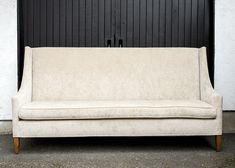 The clean lines of this ivory, velvet couch gives it a modern feel. It's shape and color are a neutral base for pillows and to be set on top a rug. Velvet Couch, Love Seat, Neutral, Lounge, Pillows, Rugs, Modern, Furniture, Color