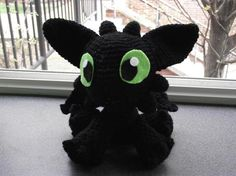"Toothless  Crocheted Toothless the Dragon from the movie ""How to Train Your Dragon"". The picture you see below is my original... The latter ones are a little bit tighter but still as cute. Willing to post more if there is a lot of interest :)    Made with black yarn, stuffing, and felt for eyes..there's a bit of red yard for the tailfin too. Just like a little stuffed animal."