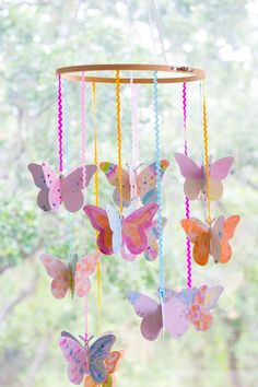 Make a DIY watercolor butterfly mobile - such a fun kids craft idea!