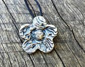 FLOWER PENDANT, sterling silver cast into carved cuttlefish bone, lovely natural texture. Each piece I make is unique!