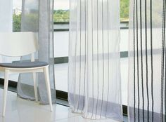 Softly flowing, wide-width sheers featuring subtly textured plains and crisp stripes, presented in light natural tones and stylish accent colours. Couture from Villa Nova