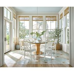 The Sail Chandelier by Regina Andrew features concentric circles to create an open sphere with a white finish. New Homes, Blue Ceilings, Decor, House, Coastal Living, Home, Sunroom Dining, Home Decor, 4 Season Room