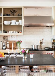 white painted brick, black soapstone counter, open shelving- use warm wood (not open cabinets), stainless accents